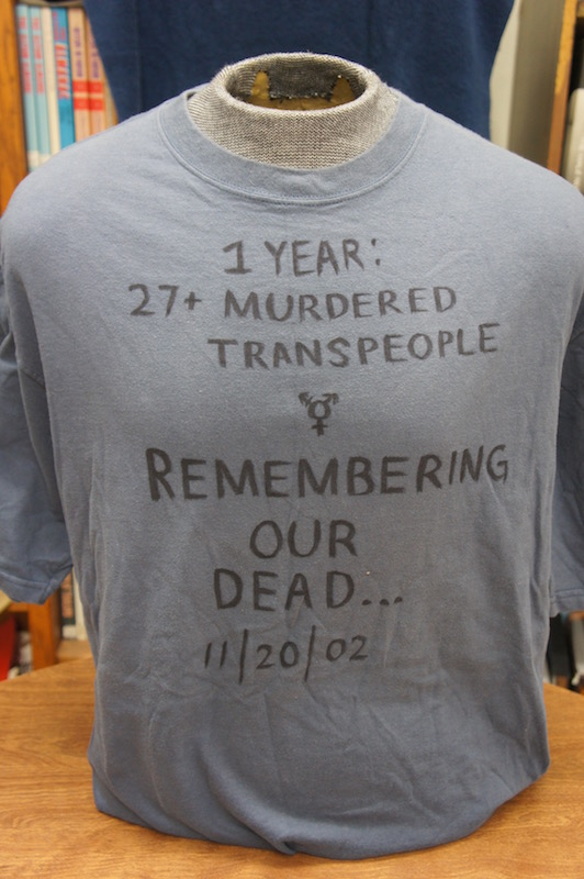 the front of a grey t-shirt with handwritten text